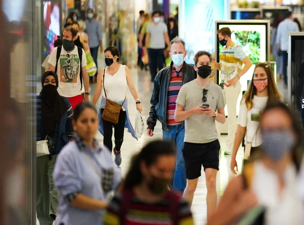 <p>Shoppers in masks</p>