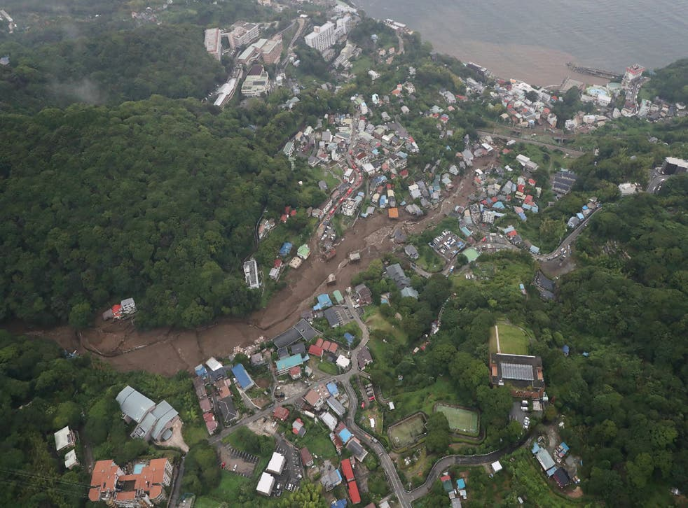 Rescuers in Japan hunt for 80 missing following deadly landslides | The  Independent