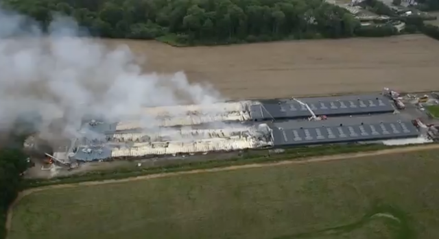 <p>Drone footage showing fire crews controlling the last of the fire</p>