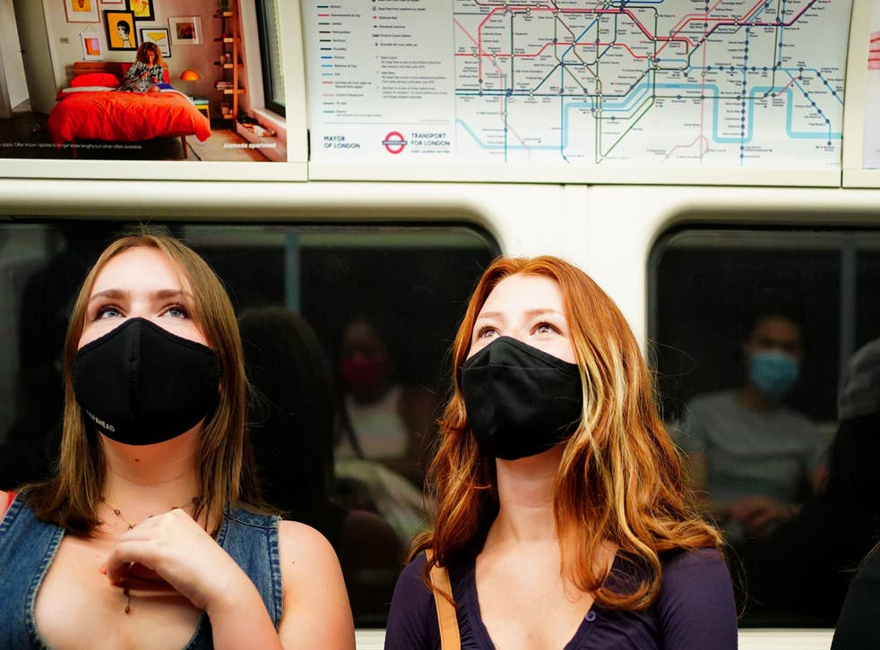 <p>Masks will no longer be compulsory in public places under government plans later this month</p>