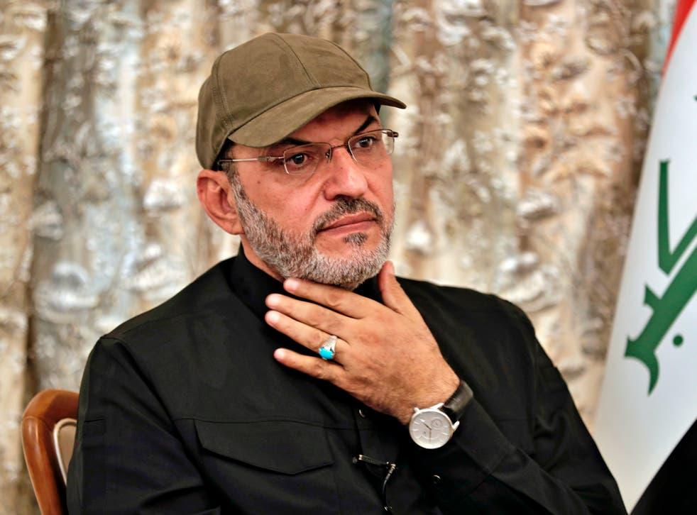 <p>Abu Alaa al-Walae, commander of Kataib Sayyid al-Shuhadam, speaks during an interview with The Associated Press</p>