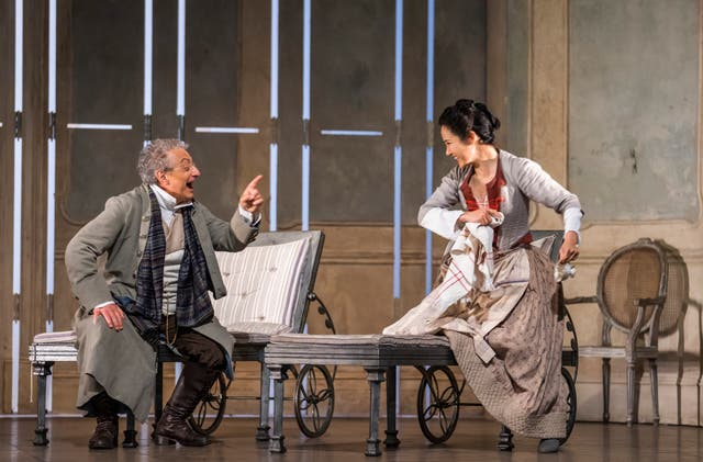 <p> Alessandro Corbelli as Don Alfonso and  Hera Hyesang Park as Despina in 'Cosi fan tutte' at Glyndebourne</p>