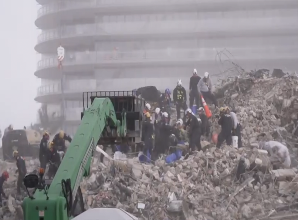 <p>Workers are battling the elements as they attempt to find survivors</p>