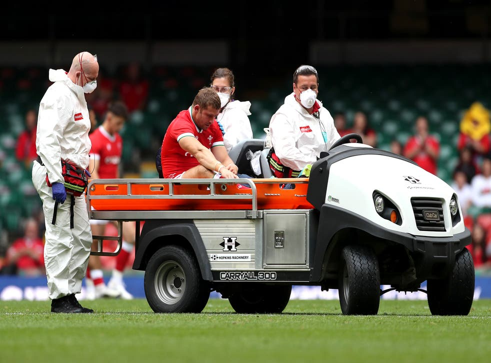 <p>Leigh Halfpenny being taken off on a stretcher cart</p>