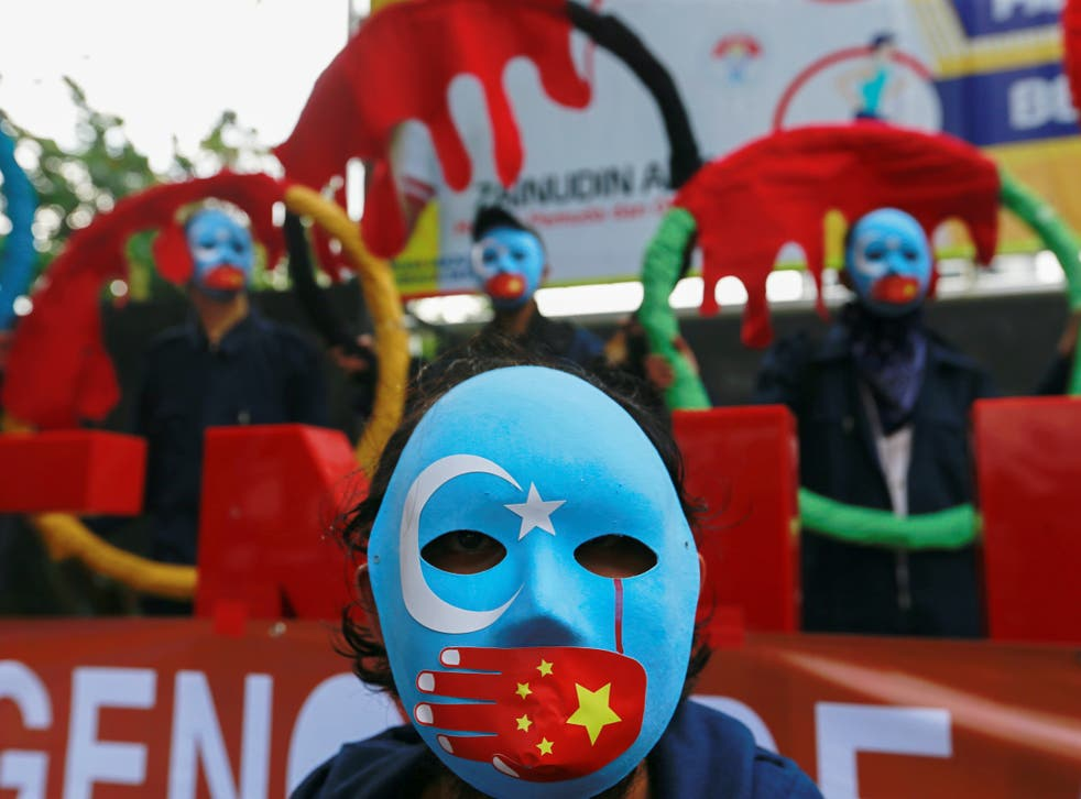 <p>Activists in Indonesia take part in protest to boycott the Beijing 2022 Winter Olympics</p>