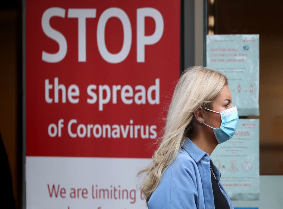 <p>Campaigners have called for masks to be kept until more people are fully vaccinated</p>