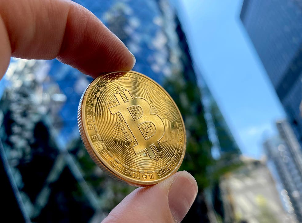 <p>A visual representation of Bitcoin cryptocurrency is pictured on May 30, 2021 in London, England</p>