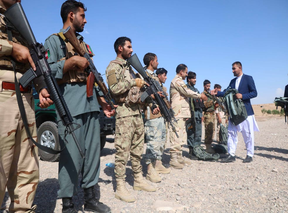 <p>Afghan security officials stand guard against the Taliban during a ceremony in Herat, near Badghis province </p>