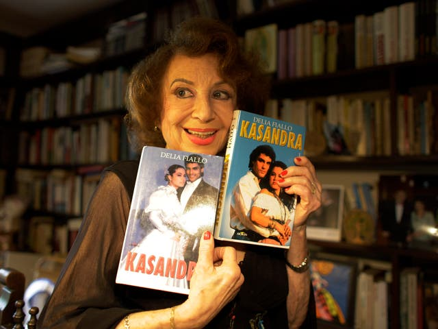 <p>The writer with book versions of her show, 'Kassandra', which was broadcast in 128 countries</p>