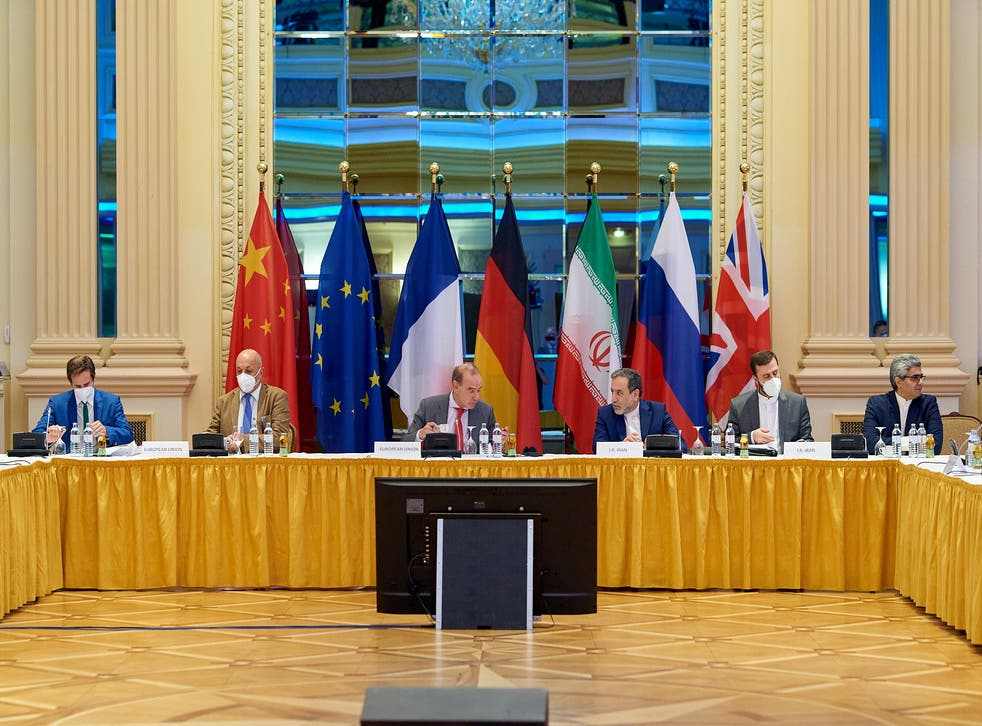 <p>Deputy Secretary General Enrique Mora and Iranian Deputy at Ministry of Foreign Affairs Abbas Araghchi wait for the start of talks on reviving the 2015 Iran nuclear deal in Vienna in June</p>