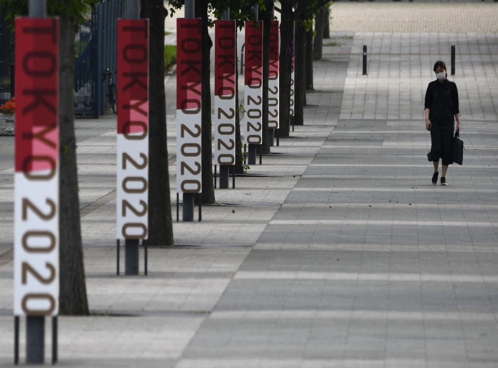 <p>The logos of Tokyo 2020 are displayed at a street near Odaiba Seaside Park in the Japanese capital</p>