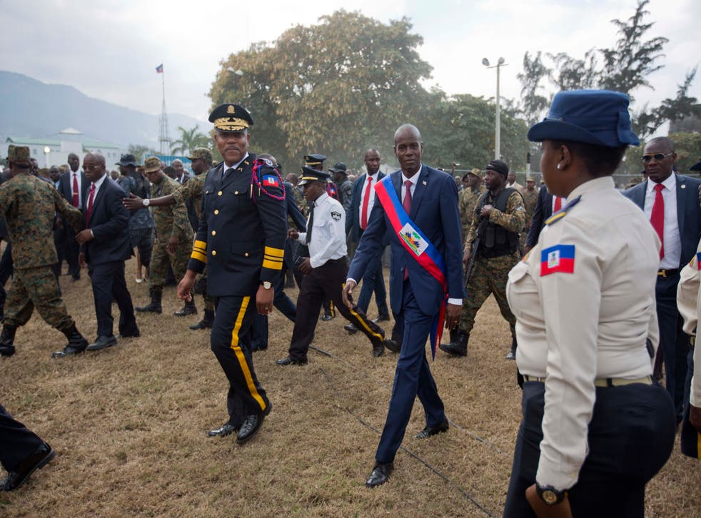 <p>Newly sworn-in Haitian President Jovenel Moise walks with Police Chief Michel-Ange Gedeon past National Police at the National Palace after his inauguration ceremony in 2017</p>