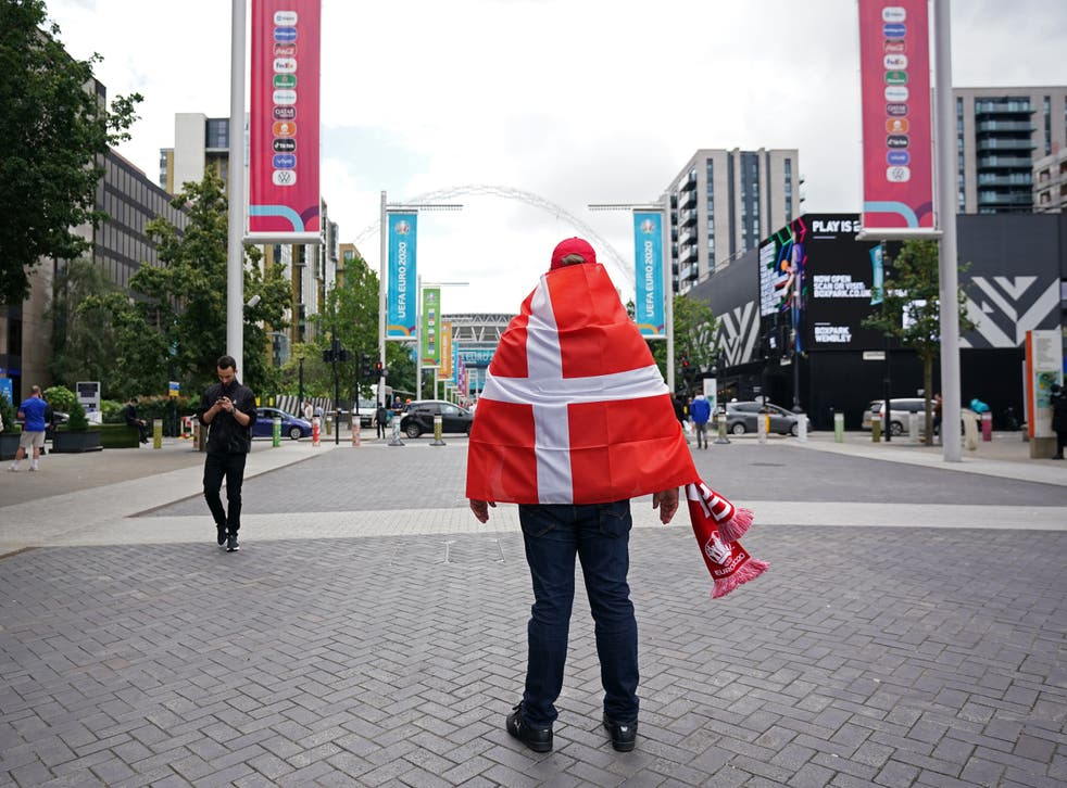 <p>A Denmark fan surveys the scene before the semi-final match started at Wembley</p>