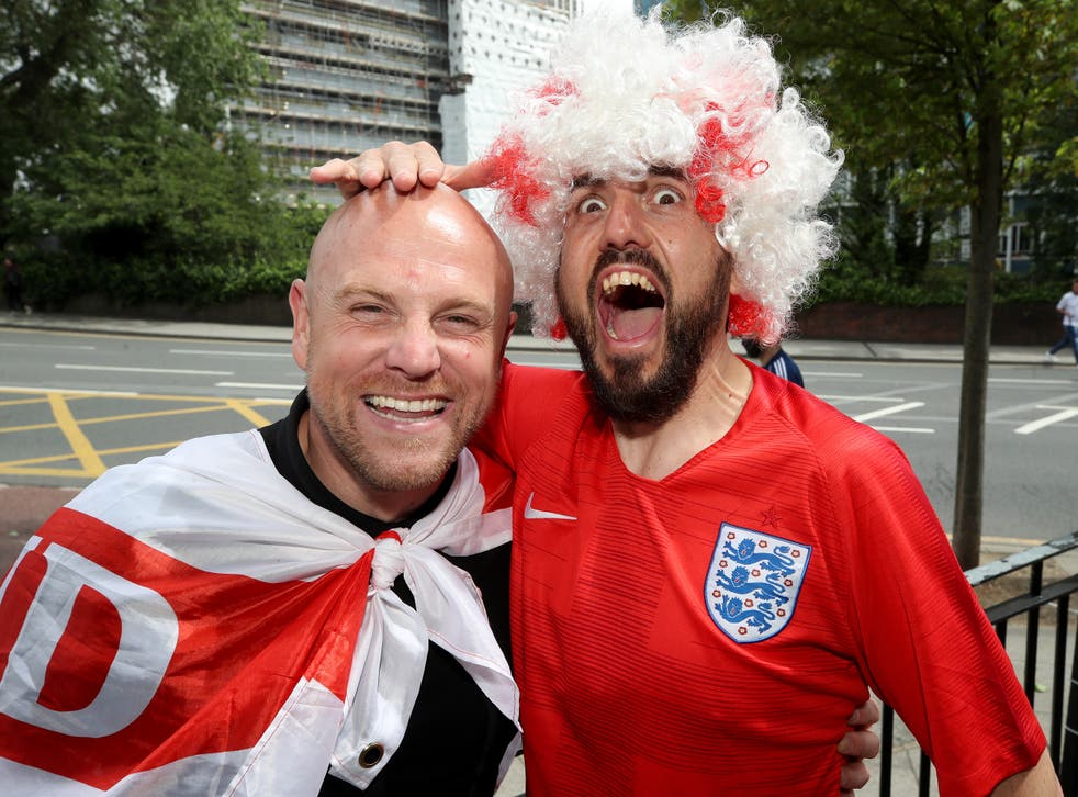 England fans pose ahead of Wednesday's game against Denmark (Nick Potts/PA)