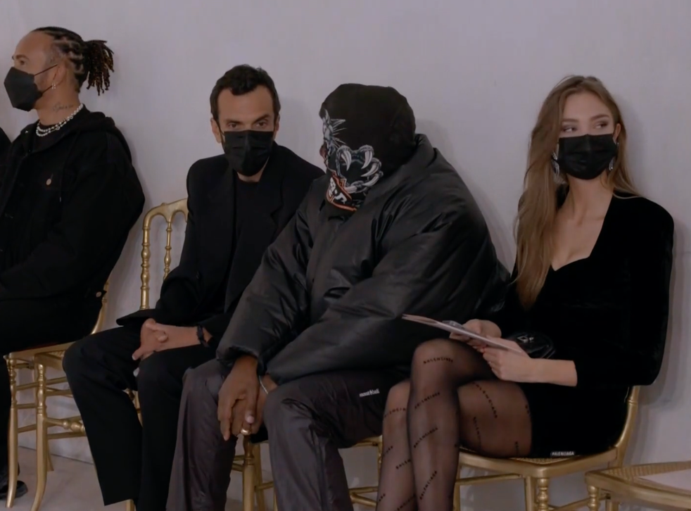 <p>Kanye West (centre) attended the Balenciaga Couture show in Paris on Wednesday 7 July 2021</p>