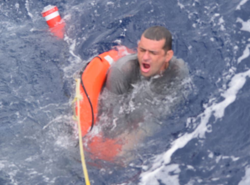 <p>The US Coast Guard rescues a man near the Florida Keys after his ship capsized due to Tropical Storm Elsa</p>