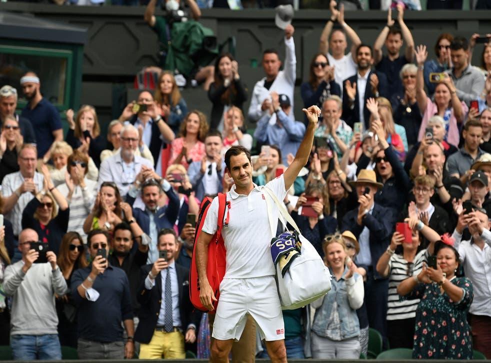 <p>Roger Federer salutes an adoring Centre Court crowd</p>
