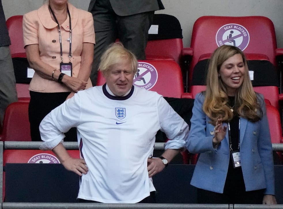 <p>Johnson and his wife Carrie at the Euro 2020 championship semi-final</p>