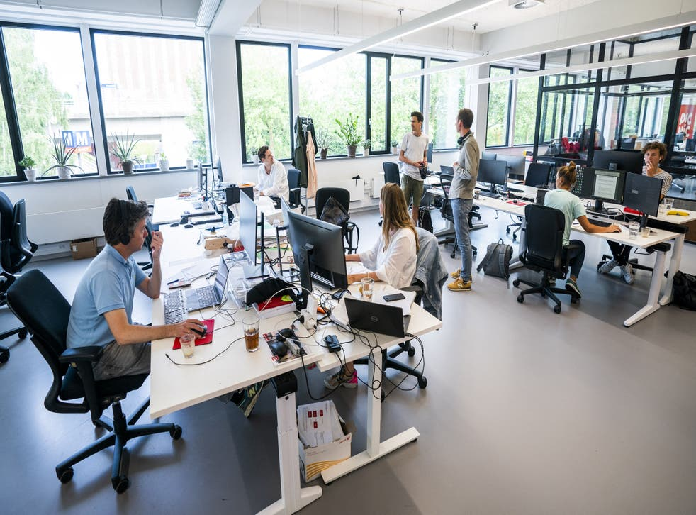 <p>Employees at the online supermarket Picnic are seen at their desks in their office in Duivendrecht, northern Netherlands on 28 June, 2021. A recent suggests burnout is driving workers to look for new opportunities.</p>