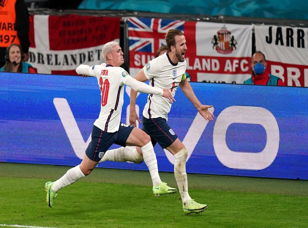 Harry Kane celebrates scoring the winner