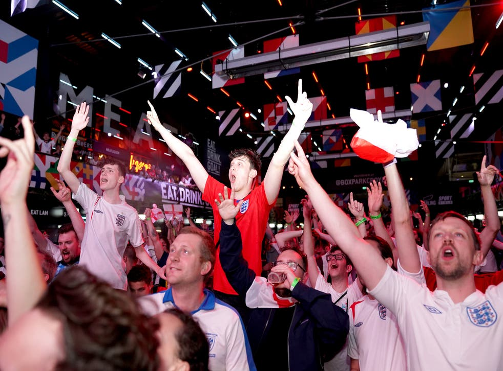 Fans celebrate England's win at the football