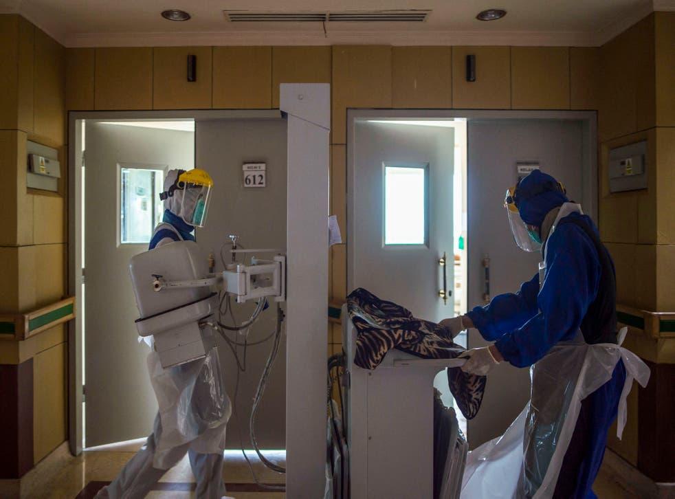 <p>Health workers prepare equipment to treat covid-19 patients at Husada Utama hospital in Surabaya, East Java, on 8 July  2021</p>