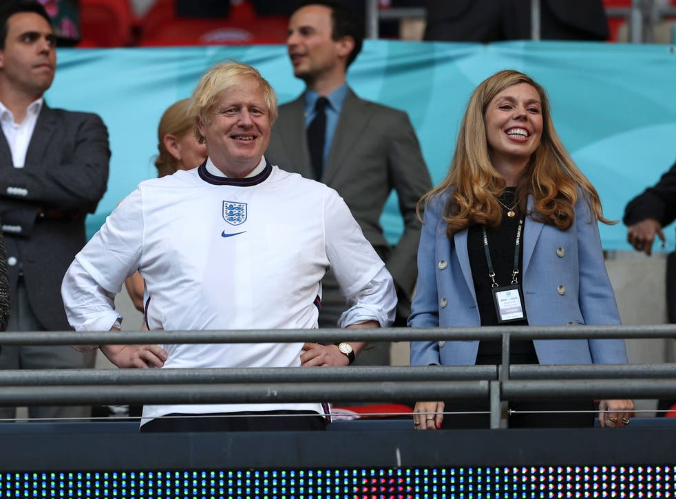 <p>Boris Johnson with his wife Carrie at Wembley on Wednesday evening</p>