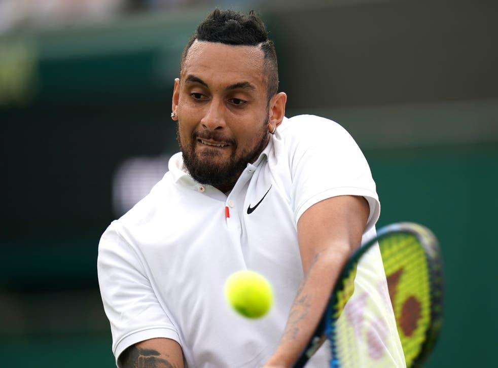 <p>Nick Kyrgios hitting a backhand at Wimbledon</p>