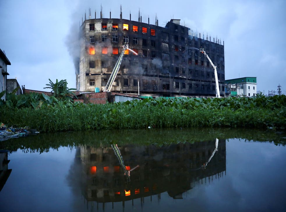 <p>Flames rise the morning after a fire broke out at the Hashem Foods Ltd factory in Rupganj, on the outskirts of Dhaka, Bangladesh</p>