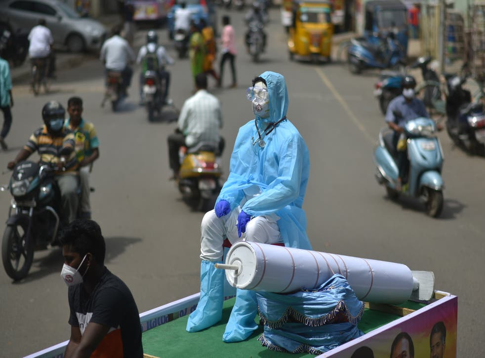 <p>NGO volunteers showcase a mannequin dressed in PPE on a cycle rickshaw during an awareness campaign against the spread of Covid-19 in Chennai, India</p>