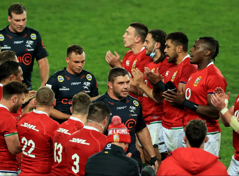 <p>The Lions applaud Sharks players</p>