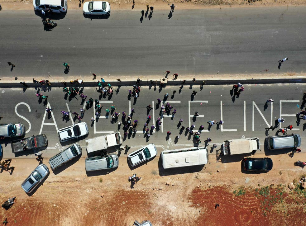 <p>A human chain is formed by workers from the civil society, humanitarian aid, and medical and rescue services in a vigil calling for maintaining a UN resolution authorising the passage of humanitarian aid into Syria's rebel-held northwestern province</p>