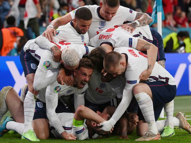 <p>England's Harry Kane, bottom, celebrates with his teammates after scoring his side's second goal during the Euro 2020 soccer semifinal match between England and Denmark at Wembley stadium in London</p>