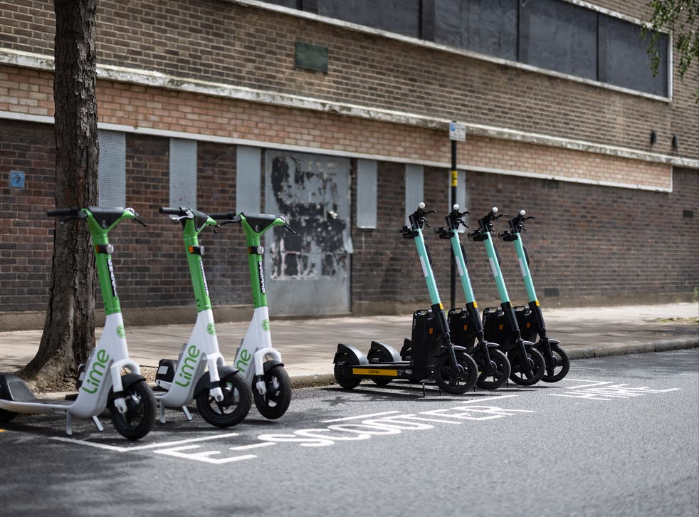<p>A row of both Lime (L) and Tier (R) electric scooters are seen in a parking bay on July 05, 2021 in London, England.</p>