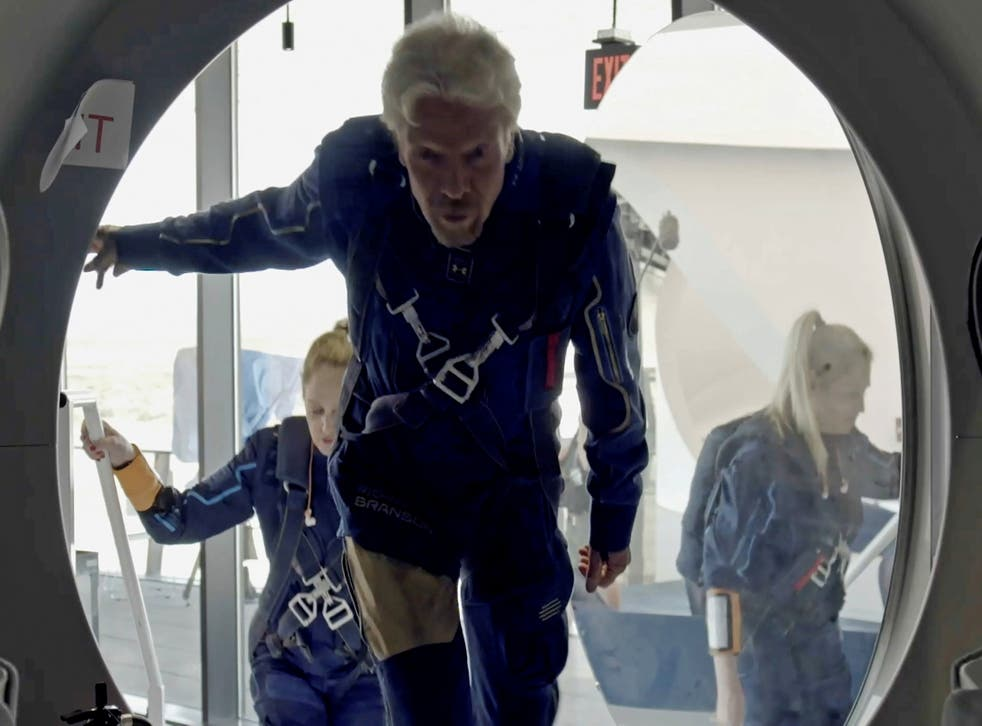 <p>Richard Branson and Virgin Galactic crew members enter the VSS Unity</p>