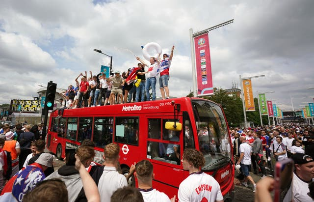 England fans climb aboard a bus outside the ground