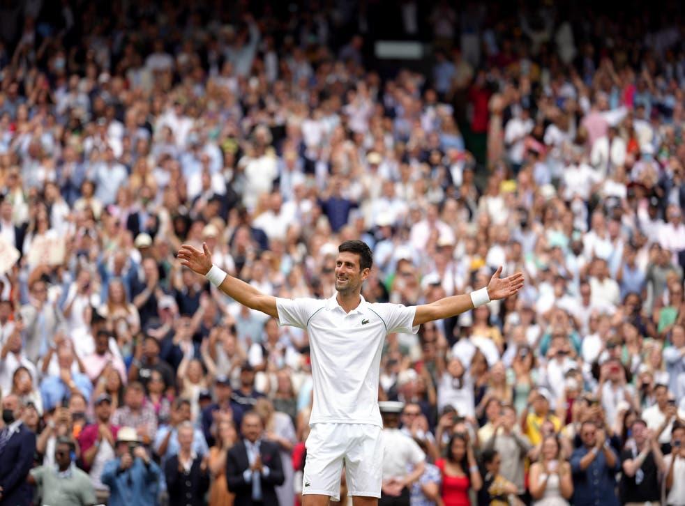 Novak Djokovic celebrates winning his 20th grand slam title