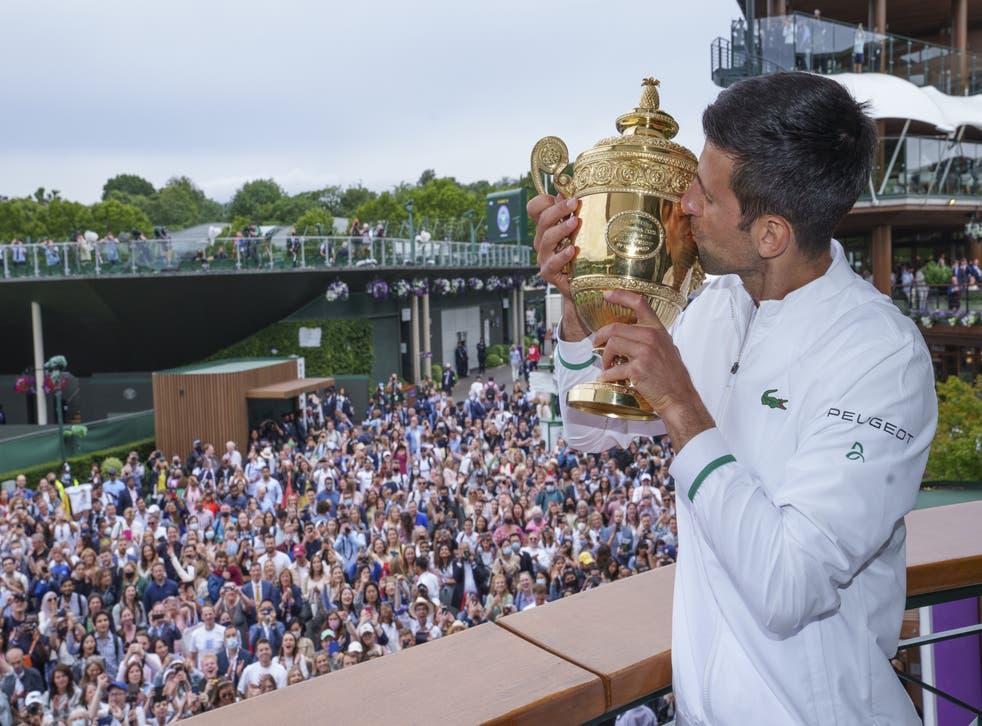 Novak Djokovic poses with the Wimbledon trophy