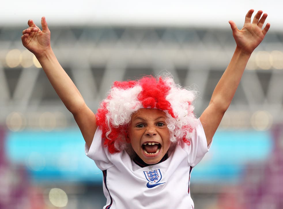 <p>: A fan of England wearing a wig shows their support along Wembley Way prior to the UEFA Euro 2020 Championship Final</p>