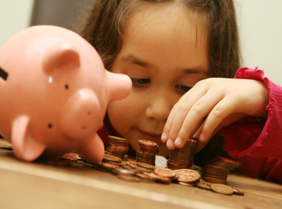 A child with a piggy bank