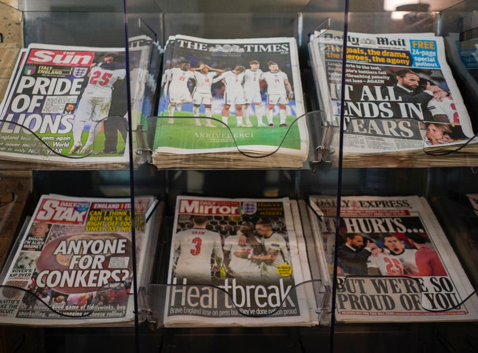 <p>Front pages of British newspapers are displayed at a newsagent in London on Monday 12 July 2021 after Italy beat England to win Euro 2020 at Wembley</p>