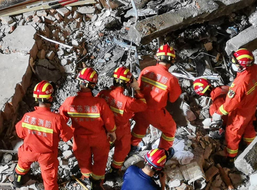 <p>Rescuers searching at the site of a hotel after it collapsed leaving at least eight dead and nine others missing in the city of Suzhou in China's eastern Jiangsu province</p>