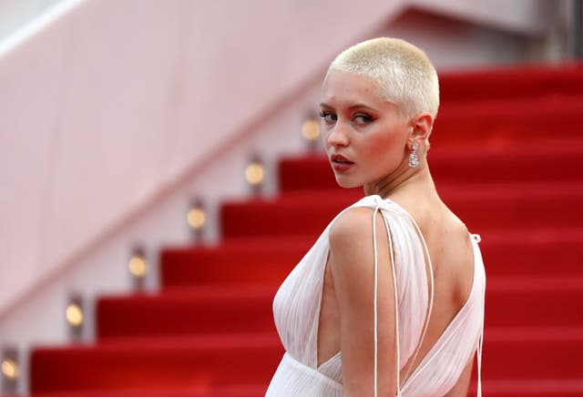 Iris Law poses for photographers upon arrival at the premiere of the film 'The French Dispatch' at the 74th international film festival, Cannes, southern France, Monday, July 12, 2021