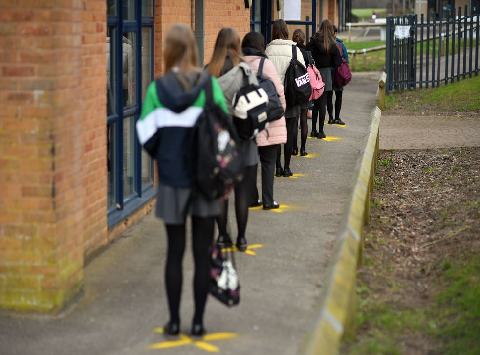 <p>Pupils queuing to take a lateral flow test at Archway School in Stroud, Gloucestershire, in March this year</p>