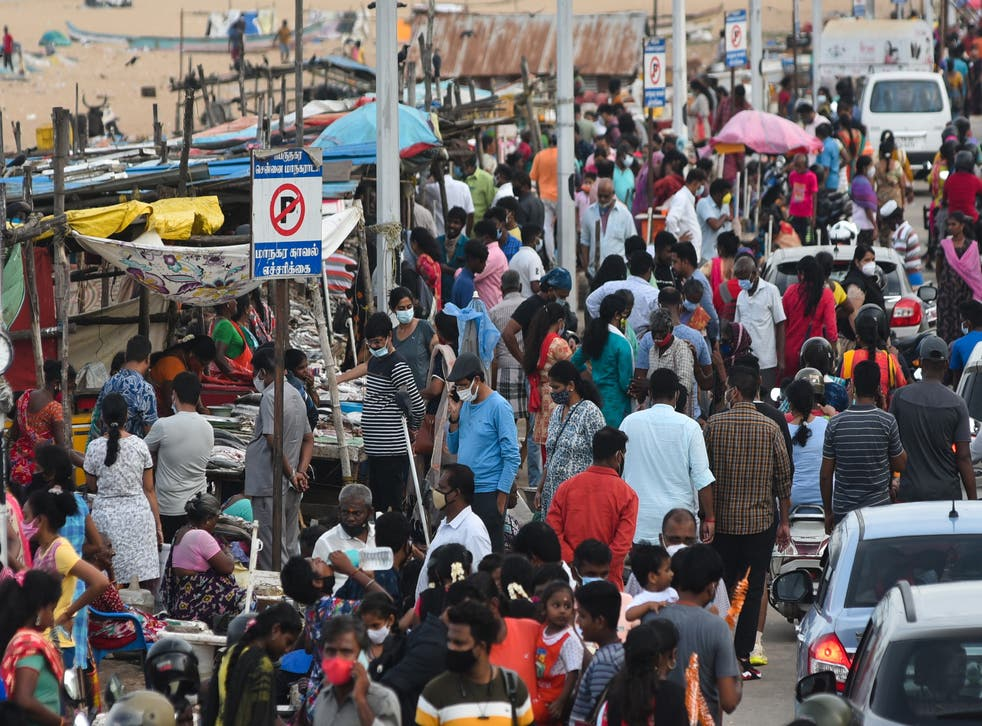 <p>People gather to visit the Marina beach following the easing of restrictions in India's Chennai on 10 July, 2021</p>
