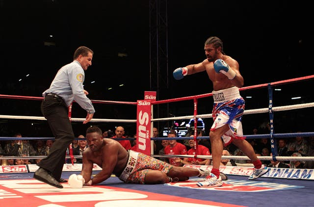 <p>David Haye (right) knocks down Dereck Chisora in the fifth round of their heavyweight bout at Upton Park in 2012</p>