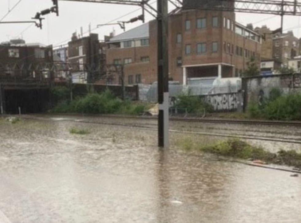 <p>Rain line: flooding outside Euston station in London</p>