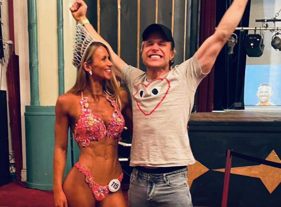 <p>Amelia Tank and Olly Murs celebrate after Tank was crowned as overall UK winner of the Pure Elite bodybuilding competition last month</p>