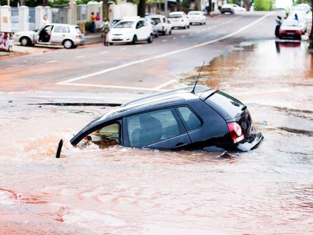 <p>A car in a sinkhole</p>