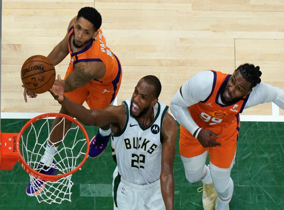 <p>Milwaukee Bucks forward Khris Middleton (22) drives to the basket during their clash with the Phoenix Suns</p>